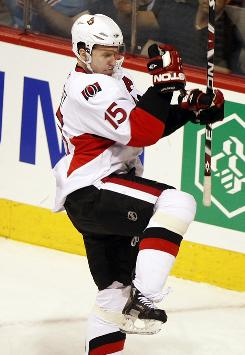 The Senators' Dany Heatley pumps his fist in celebration after scoring one of his two goals on the night as Ottawa topped the Canadiens 3-2.