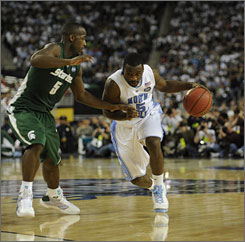 North Carolina point guard Ty Lawson, driving past Michigan State's Travis Walton during the second half of the Tar Heels' victory in Detroit, set a Final Four record with eight steals in the national championship game.