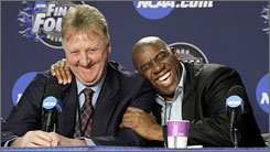 Former NBA players Magic Johnson, right, and Larry Bird share a laugh at a news conference before the NCAA championship game between Michigan State and North Carolina in Detroit. Thirty years ago, Johnson's Michigan State team played Bird's Indiana State team in the title game.