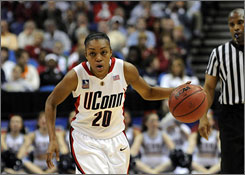 Connecticut's Renee Montgomery, dribbling up court during Sunday's semifinal against Stanford, was named the top point guard and the best player 5-7 or shorter this season.