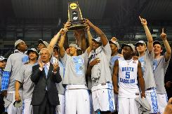 North Carolina hoists the National Championship trophy after defeating Michigan State, 89-72. For the Tar Heels, it was their second title in five years.