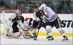 Kris Versteeg, right, and the Blackhawks put a dent in the Predators' playoff hopes with the 4-2 road victory.