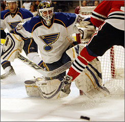 Chris Mason of the St. Louis Blues, making a save during an April 1 game against the Blackhawks, has been solid in the net, giving the team a foundation to build on. They have an outside chance of making the playoffs this season.