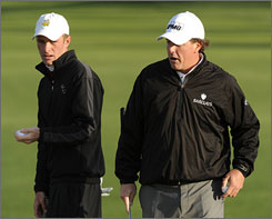Phil Mickelson and playing partner Drew Kittleson had to bundle up Tuesday morning for their practice round.