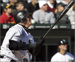 Jim Thome watches the flight of his game-winning home run in the White Sox's 4-2 win over the Kansas City Royals in their home opener.
