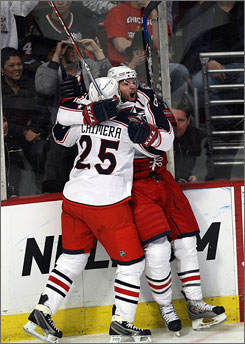 The Blue Jackets' Rick Nash gets mobbed by teammate Jason Chimera after scoring the game-tying goal in the third period as Columbus booked its first NHL postseason ticket.