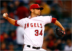 Angels pitcher   Nick Adenhart, who pitched six shutout innings Wednesday night against the Athletics, was killed in an automobile accident early Thursday morning.