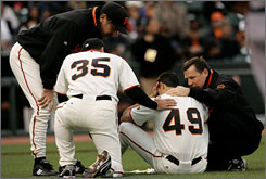 San Francisco's Joe Martinez sits on the ground after being hit in the head by the Brewers'    Mike Cameron's double in San Francisco. Martinez would not be hurt, and the Giants went on to win 7-1.