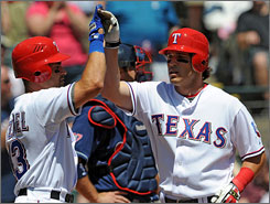 Second baseman    Ian Kinsler hit a two-run home run in the second inning and drove in a third run to guide the Rangers past the Indians.