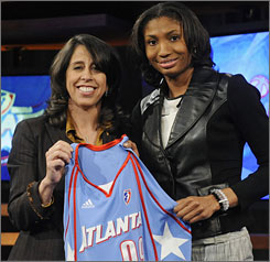 Louisville's Angel McCoughtry, right, shows off her new Atlanta Dream jersey with WNBA president Donna Orender.