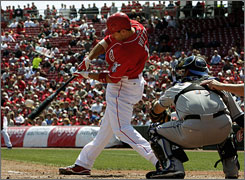 Reds' Joey Votto hits an RBI single of Mets' Oliver Perez in the fifth inning. Earlier in the thurd, the first baseman hit a three-run homer.