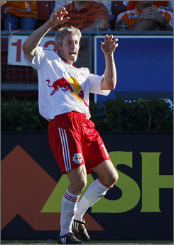 The Red Bulls' John Wolyniec celebrates after scoring against the Dynamo in last fall's playoffs.