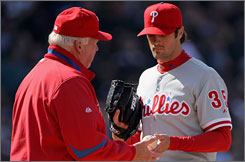 World Series MVP Cole Hamels had a rough debut. The left-hander allowed seven runs and 11 hits in 3 2/3 innings, including a five-run third in the loss.