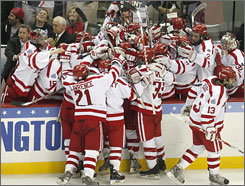 Boston University celebrates after Nick Bonino scored the game-tying goal in the last minute of the third period. The Terriers went on to beat Miami (Ohio) 4-3 in overtime.