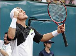 Lleyton Hewitt of Australia celebrates his 7-6 (7-4), 6-4 win over Evgeny Korolev in the semifinals. It was Hewitt's 498th career win.