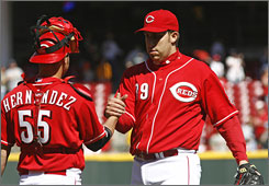 Cincinnati Reds pitcher Aaron Harang, right, is congratulated by catcher Ramon Hernandez, after Harang's complete-game, two-hit shutout.