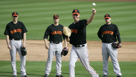 """From left, Giants pitchers Joseph Martinez, Billy Sadler and Jonathan Sanchez watch Randy Johnson, 45, during spring training. """"If Randy Johnson is going to say something to you, of course you're going to pay attention,"""" pitcher Tim Lincecum, 24, says of his legendary teammate."""