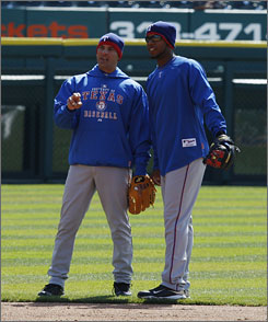 "Texas Rangers shortstop Elvis Andrus, right, is learning the position from 11-time Gold Glove winner Omar Vizquel, 41. ""He tells me 80% of the game is preparation,"" says Andrus, 20, of Vizquel."