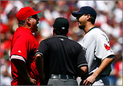 Angels manager Mike Scioscia is seperated by umpire Ed Rapuano while arguing with pitcher   Josh Beckett after a pitch went high-and-inside to   Bobby Abreu. 