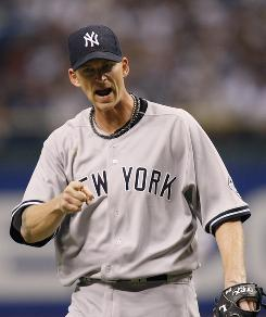 Yankees pitcher A.J. Burnett exults after catcher Jose Molina picked off a base runner to get out of a jam. Burnett did his share as well, taking a no-hitter into the seventh inning on the way to a 7-2 New York victory over the Tampa Bay Rays.