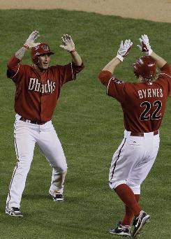 The Arizona Diamondbacks'      Felipe Lopez celebrates the game-winning hit by teammate      Eric Byrnes in the 10th against the St. Louis Cardinals.