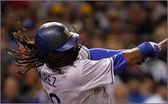 Manny Ramirez's dreadlocks and bat are hot in Los Angeles. His wigs sell for $25 in the Dodgers gift shop and are seen throughout the ballpark.