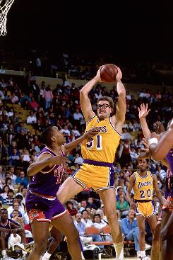 Kurt Rambis brings down a tough board, demonstrating the style of play that gave the All-Rambis team its name.