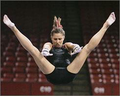 Georgia senior Courtney Kupets, performing on the uneven bars during a practice session Wednesday, was the 2006 and 2007 NCAA all-around champion.