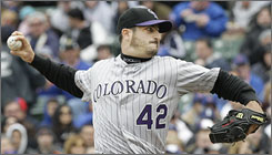 Rockies pitcher    Jason Marquis improved to 2-0 after beating the Cubs, the team he spent the last two seasons with.