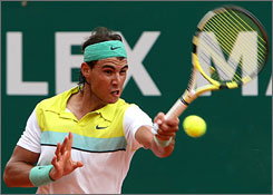 Spain's Rafael Nadal, returning the ball to Argentina's Juan Ignacio Chela, advanced to the third round at the Monte Carlo Masters. Nadal is bidding for his fifth consecutive title at the event.