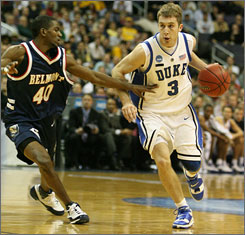 After a heralded prep football career, Greg Paulus chose to play four seasons with the Duke basketball team.