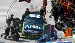 Carl Edwards comes in for a pit stop at Martinsville Speedway last month. A shoddy pit stop hurt him April 5 in the Samsung 500.
