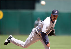 Red Sox Tim Wakefield pitched a no-hitter through seven innings against the Athletics. He finished with a two-hit, complete game victory.