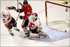 The Blackhawks' Martin Havlat (16) can't see his shot go past Flames goalie Miikka Kiprusoff 12 seconds into overtime for Chicago's game-winning goal in Game 1.