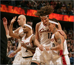 From left, the Cavaliers' Zydrunas Ilgauskas, Mo Williams, Anderson Varejao and Delonte West celebrate while coming off the court against the New Jersey Nets in Cleveland. The Cavs take on the Pistons in the first round of the playoffs.
