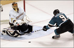 Ducks goalie Jonas Hiller, stopping the Sharks' Milan Michalek in the second period, made 35 saves in his playoff debut, stunning San Jose in the process.