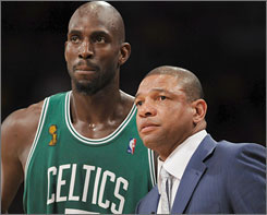 Boston coach Doc Rivers, right, might not have    Kevin Garnett for the NBA playoffs. The pair talked during the Celtics' championship run last spring.