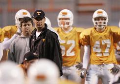 Controversial Tennessee head coach Lane Kiffin looks on during a spring practice at Neyland Stadium.