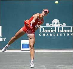 Elena Dementieva returns against Dominika Cibulkova.