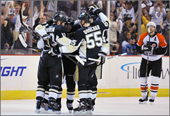 The Penguins celebrate a goal by Bill Guerin, left, in Game 2 of their first-round playoffs against the Flyers in Pittsburgh.
