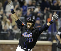 The New York Mets' Gary Sheffield celebrates after hitting his 500th career home run during the seventh inning. The solo shot, tied the game against the Brewers, 4-4.