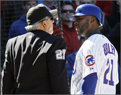 Cubs' Milton Bradley argues with home plate umpire Larry Vanover after being called out on strikes Thursday.