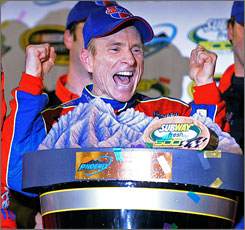 Mark Martin celebrates after winning the Subway Fresh Fit 500 on Saturday night. The victory was Martin's first in nearly four years and made him the third-oldest winner in NASCAR history.