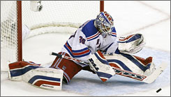 Rangers goalie Henrik Lundqvist made 35 saves to secure a 1-0 victory against the Capitals in Game 2 of the first round.