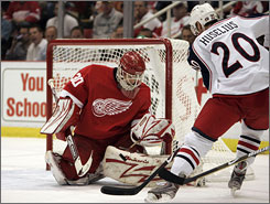 Red Wings goalie Chris Osgood stopped 25 Blue Jackets' shots to help Detroit take a 2-0 series lead.