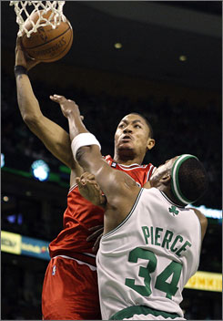 Bulls rookie guard Derrick Rose takes it to the hoop for two of his game-high 36 points against the Celtics.
