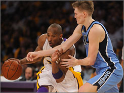 Lakers guard    Kobe Bryant takes an elbow from Jazz defender    Andrei Kirilenko during a second-half drive in Game 1.