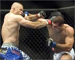 Mauricio Rua, right, lands a punch against Chuck Liddell.