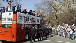 The Connecticut Huskies wave to fans during a parade in their honor after the team defeated Louisville to win the women's NCAA championship on April 7.