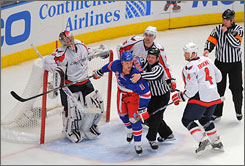New York's        Sean Avery gets into a war of words with members of the Washington Capitals in the waning moments of Washington's 4-0 Game 3 win on Monday night. The Rangers lead the Capitals in the best-of-seven series, 2-1.